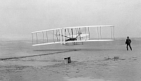 0001274 © Granger - Historical Picture ArchiveWRIGHT BROTHERS, 1903.   First heavier-than-air flight of the Wright Brothers at Kitty Hawk, North Carolina. Photograph, 17 December 1903.