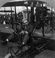 0117499 © Granger - Historical Picture ArchiveART SMITH (1894-1926).   American aviator, stunt pilot and pioneer of skywriting at night. Photographed seated in the cockpit of his biplane on the aviation field at the Panama-Pacific International Exposition, San Francisco, California. Stereograph, 24 June 1915.