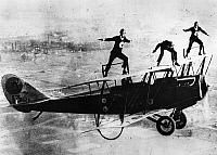 0171755 © Granger - Historical Picture ArchiveWING WALKING, c1925.   Left to right: Spider Matlock, Al Johnson and Fronty Nichols performing stunts on the wings of a biplane piloted by Bon MacDougall. Photograph, c1925.