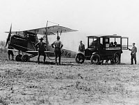 0259731 © Granger - Historical Picture ArchiveU.S. AIR MAIL, c1918.   A United States Mail car delivering mail to an airplane. Photograph, c1918.