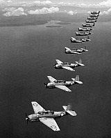 0028395 © Granger - Historical Picture ArchiveAVENGER BOMBERS, 1943.   A flight of twelve Grumman 'Avenger' torpedo-bombers over the South Pacific, 1943, during World War II.