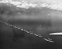 0076691 © Granger - Historical Picture ArchiveU.S.NAVY AIRCRAFTS, 1943.   U.S. Navy TBFs flying high above Espiritu Santo in the New Hebrides, South Pacific, 1943.