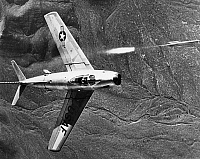 0091268 © Granger - Historical Picture ArchiveF-86 JET FIGHTER PLANE.   The North American F-86 Sabre combat aircraft releasing a rocket during training operations over the Nevada Desert Gunnery Range, 1951.