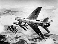 0091521 © Granger - Historical Picture ArchiveF-100 FIGHTER PLANES, 1957.   F-100 Super Sabre fighter jets flying in formation in a still from Lowell Thomas' Cinerama documentary, 'Search for Paradise,' 1957.