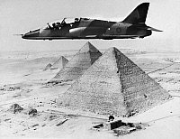 0091555 © Granger - Historical Picture ArchiveHAWKER SIDDELEY HAWK, 1975.   A Hawker Siddeley Hawk fighter jet trainer in flight over the Giza Pyramids during a sales drive for an Egyptian contract, 1975.