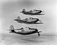 0091717 © Granger - Historical Picture ArchiveWWII: FIGHTER PLANES.   A squadron of Bell P-39 Airacobra fighter planes of the Army Air Corps flying in formation during World War II.
