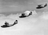0091743 © Granger - Historical Picture ArchiveCOAST GUARD FLYING BOATS.   Coast Guard Hall PH-3 long range flying boats in formation. Mid-20th century photograph.