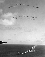 0091754 © Granger - Historical Picture ArchiveBATTLESHIPS & AIRCRAFT.   American battleships and aircraft engaged in fleet maneuvers off the California coast. Mid-20th century photograph.