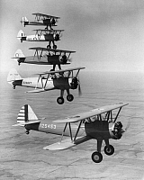 0091767 © Granger - Historical Picture ArchiveWWII: BOEING TRAINER PLANES.   Boeing military trainer airplanes bound for five different services (from top to bottom): Peru, Great Britain, China, U.S. Navy and U.S. Air Corps. Photographed during a demonstration, 1942.