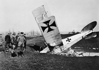 0171750 © Granger - Historical Picture ArchiveWORLD WAR I: PLANE CRASH.   Wreckage of a German fighter plane piloted by Lieutenant Kirsch at the Stenay Airfield in France during World War I. Photograph, c1916.