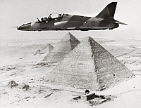 0260344 © Granger - Historical Picture ArchiveHAWKER SIDDELEY HAWK, 1975.   A Hawker Siddeley Hawk fighter jet trainer in flight over the Giza Pyramids during a sales drive for an Egyptian contract, 1975.