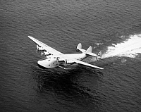 0058037 © Granger - Historical Picture ArchiveBOEING 314 CLIPPER, 1939.   The Pan American 'Yankee Clipper,' powered by four Wright 'Cyclone' radial twin-row 14 cylinder air-cooled engines rated at 1600 hp. Photographed at take-off in 1939.