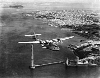 0114701 © Granger - Historical Picture ArchiveCHINA CLIPPER, 1935.   The Pan American Martin M-130 flying boat 'China Clipper,' leaving San Francisco on the first transpacific airmail flight to Honolulu, Midway, Wake, Guam, and Manila, 22 November 1935.