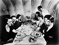 0114708 © Granger - Historical Picture ArchivePASSENGER AIRCRAFT, 1936.   Dinner being served onboard a M-130 Pan American Airways flying boat, 1936.