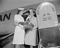 0120034 © Granger - Historical Picture ArchivePEACH DELIVERY, 1939.   Wife of Arkansas congressman Ezekiel C. Gathings (left), receives a basket of peaches via American Airlines, to be presented to President Franklin D. Roosevelt to commemorate the annual Peach Festival held in Forest City, Arkansas. Next to Mrs. Gathings is stewardess Doris Fontaine. Photographed in Washington, D.C., July 1939.