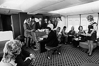 0171800 © Granger - Historical Picture ArchiveAMERICAN AIRLINES LOUNGE.   The piano lounge on an American Airlines Boeing 747 airplane. Photograph, c1975.