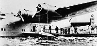0259746 © Granger - Historical Picture ArchiveDIXIE CLIPPER, 1939.   Passengers boarding the Boeing 314 'Dixie Clipper' for the first transatlantic passenger flight from Port Washington, Long Island, New York, to Marseilles, France. Photograph, 28 June 1939.