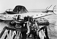 0259747 © Granger - Historical Picture ArchiveDIXIE CLIPPER, 1939.   Passengers deplaning the Boeing 314 'Dixie Clipper' at Lisbon, during the first transatlantic passenger flight en route to Marseilles, France. Photograph, June 1939.