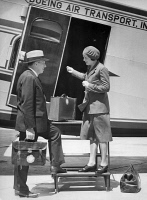 0351613 © Granger - Historical Picture ArchiveELLEN CHURCH (1904-1965).   American pilot, nurse, and first female flight attendant. Church welcoming a traveller onto a Boeing Air Transport airplane. Photograph, 1930.