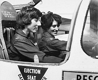 0091881 © Granger - Historical Picture ArchiveNAVIGATOR TRAINEES, 1977.   U.S. Air Force 2nd Lieutenant Florence Fowler and Captain Margaret Stanek, two of the first women to become navigators in the U.S. Air Force, during training, 1977.