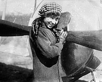 0117363 © Granger - Historical Picture ArchiveKATHERINE STINSON (1891-1977).   American aviator, flight instructor and mail carrier. Known on the exhibition circuit as 'Flying Schoolgirl.' On July 18, 1915, Stinson became the first woman to perform a loop, at Cicero Field in Chicago, and went on to perform this feat some 500 times without a single accident. Photographed holding the propeller, c1915.