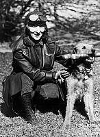 0119984 © Granger - Historical Picture ArchiveAVIATOR WITH DOG, c1922.   An unidentified female aviator, posed with President Warren G. Harding's dog, Laddie Boy. Photograph, c1922.