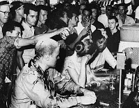 0131427 © Granger - Historical Picture ArchiveLUNCH COUNTER SIT-IN, 1963.   Three demonstrators at a lunch counter sit-in in Jackson, Mississippi, are smeared with ketchup, mustard and sugar by integration opponents, 1963.