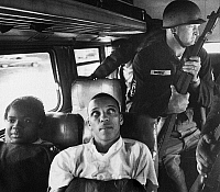 0131430 © Granger - Historical Picture ArchiveFREEDOM RIDERS, 1961.   Freedom Riders David Dennis, Julia Aaron and 25 others are escorted by the Mississippi National Guard as they travel on an interstate bus in 1961.