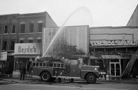 0325973 © Granger - Historical Picture ArchiveWASHINGTON: RIOTS, 1968.   Firemen hosing down buildings that were burned during the riots in Washington, D.C. that followed the assassination of Martin Luther King, Jr. Photograph by Warren K. Leffler, 8 April 1968.