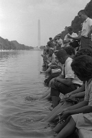 0528426 © Granger - Historical Picture ArchiveMARCH ON WASHINGTON, 1963.   Demnonstrators resting with their feet in the Lincoln Memorial Reflecting Pool during the March on Washington. Photograph by Warren K. Leffler, 28 August 1963.