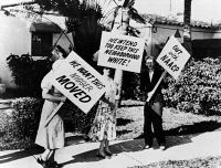 0622151 © Granger - Historical Picture ArchiveRACIST PICKETING, 1957.   White women picketing with racist signs outside of the home of African American entertainer Frank Legree in Miami, Florida. Photograph, 1957.