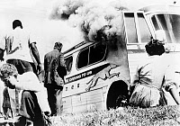 0622731 © Granger - Historical Picture ArchiveFREEDOM RIDERS, 1961.   A group of Freedom Rider civil rights activists watch as their bus burns, Anniston, Alabama. Photograph by Joe Postiglione, 1961.