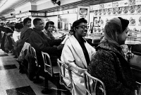 0623286 © Granger - Historical Picture ArchiveLUNCH COUNTER SIT-IN, 1960.   African Americans seated at a segregated lunch counter in Nashville, Tennessee, during a sit-in. Photograph, 1960.