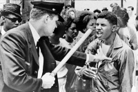0623568 © Granger - Historical Picture ArchiveCIVIL RIGHTS MARCH, 1964.   A police officer wielding a nightstick against an African American during a civil rights march in Nashville, Tennessee. Photograph, 1964.