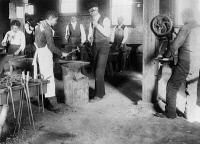 0621436 © Granger - Historical Picture ArchiveBLACKSMITHING, c1899.   Blacksmithing students at Agricultural and Mechanical College in Greensboro, North Carolina. Photograph, c1899.