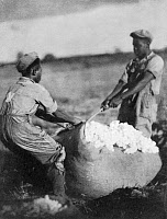 0036072 © Granger - Historical Picture ArchiveCOTTON PICKING, c1930.   Two men hauling a bale of cotton. Photographed, c1930-32, probably in South Carolina, by Doris Ulmann.