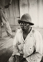 0118956 © Granger - Historical Picture ArchiveSUGAR MILL WORKER, 1934.   African American sugar mill worker at at Alma Plantation, False River, Louisiana. Photograph by Alan Lomax in July 1934.