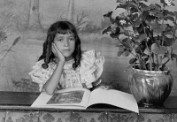 0621412 © Granger - Historical Picture ArchiveGIRL READING, c1899.   Photograph by Thomas E. Askew of his daughter with a book, c1899.