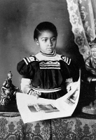 0622427 © Granger - Historical Picture ArchiveGIRL, c1899.   Portrait of an African American girl from Georgia with an illustrated book. Photograph, c1899.