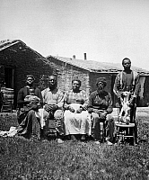 0038101 © Granger - Historical Picture ArchiveBLACK HOMESTEADERS.   A black family photographed in 1887 before their homestead in Nebraska.