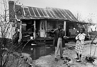 0171925 © Granger - Historical Picture ArchiveSOUTH CAROLINA: HOUSE.   An Americorps VISTA volunteer Leroy Sneed (left) talking with a home owner about repairing or rebuilding her home in rural South Carolina. Photograph, 1973.