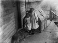 0621298 © Granger - Historical Picture ArchiveGEORGIA: CHILDREN, c1899.   Two African American children and a pet dog on a porch of a home in Georgia. Photograph, c1899.