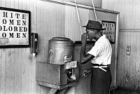 0001340 © Granger - Historical Picture ArchiveJIM CROW LAWS, 1939.   A segregated water fountain at Oklahoma City, Oklahoma. Photographed by Russell Lee, 1939.
