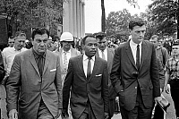 0108382 © Granger - Historical Picture ArchiveJAMES MEREDITH (1933- ).   Civil rights activist and the first African American to attend the University of Mississippi. Meredith walking to class accompanied by two U.S. Marshals, 1 October 1962. Photographed by Marion S. Trikosko.