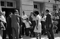 0125850 © Granger - Historical Picture ArchiveDESEGREGATION, 1963.   Vivian Malone entering Foster Auditorium to become one of the first black students to attend the University of Alabama on 11 June 1963, passing through a crowd that includes photographers, National Guard members, and Deputy U.S. Attorney General Nicholas Katzenbach. Photographed by Warren K. Leffler.