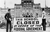 0621551 © Granger - Historical Picture ArchiveARKANSAS: LITTLE ROCK, 1958. White students stand in front of Central High School in Little Rock, Arkansas with a sign reading