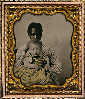 0184712 © Granger - Historical Picture ArchiveNANNY AND CHILD, c1855.   A slave woman holding a white child. Hand-tinted ambrotype, c1855.