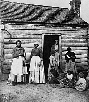 0260141 © Granger - Historical Picture ArchiveSLAVE CABIN, c1850.   Slave women and children in front of their cabin. Photograph, c1850.