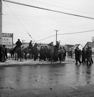 0370733 © Granger - Historical Picture ArchiveDETROIT, 1942.   Mounted police surrounding a group of black men during a riot caused by white residents attempting to keep black families from moving into the Sojourner Truth homes in Detroit, Michigan. Photograph by Arthur Siegel, February 1942.