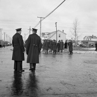 0370734 © Granger - Historical Picture ArchiveDETROIT, 1942.   Police during a riot caused by white residents attempting to keep black families from moving into the Sojourner Truth homes in Detroit, Michigan. Photograph by Arthur Siegel, February 1942.